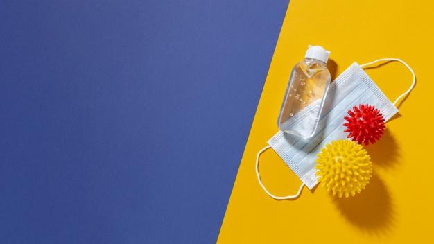 Більшість опитаних українців не хочуть вакцинуватись від COVID-19 - Щеплення, українці, Вакцинація, вакцина, COVID-19 - flat lay of medical mask with viruses and copy space 23 2148781194 1
