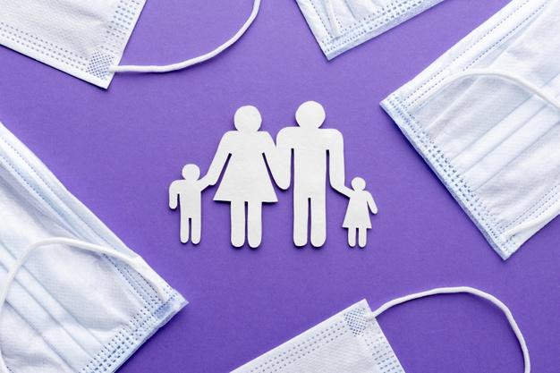 Шмигаль представив «дорожню карту» вакцинації від COVID-19 - Щеплення, українці, коронавірус, Вакцинація - top view of family made of paper with medical masks 23 2148781246