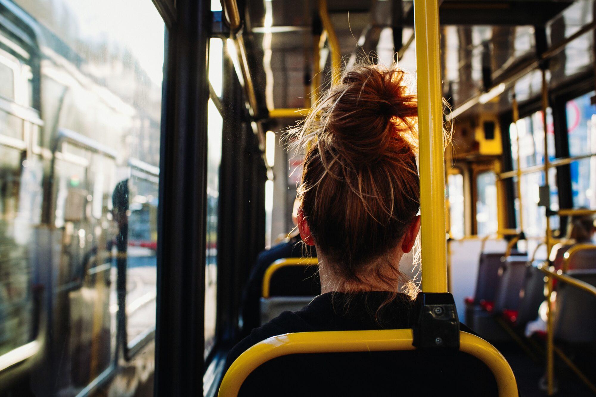 Кілька перевізників Київщини підвищили вартість проїзду без погодження з управлінням - тарифи, маршрутки, громадський транспорт, вартість проїзду - female sitting bus captured from 2000x1333
